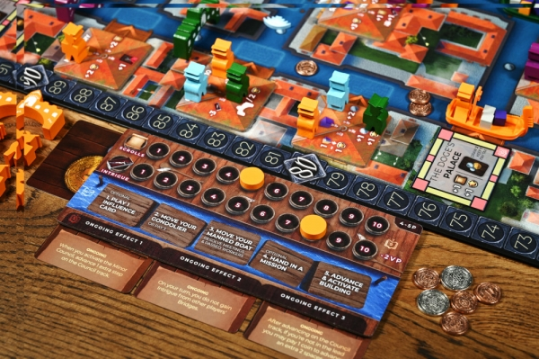A view of a player board with the scrolls and intrigue tracks. Note that the metal coins are an upgrade, not standard.
