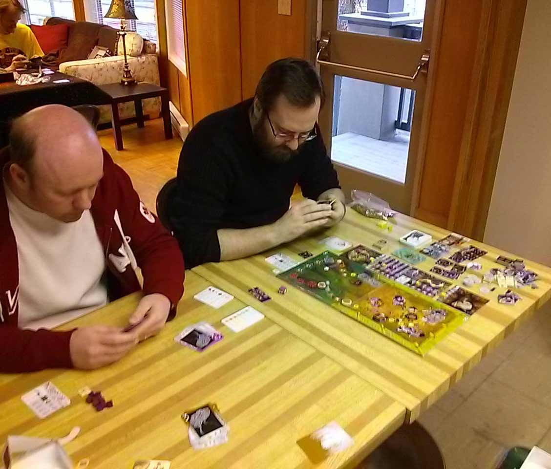 dudes playing Mushroom Eaters board game
