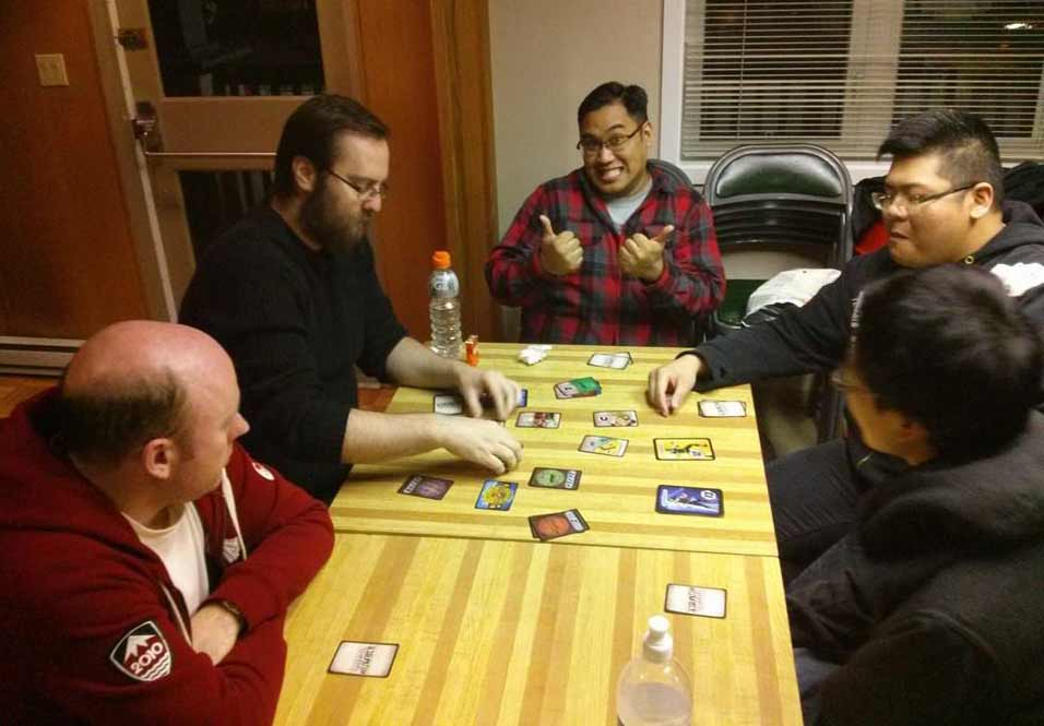 dudes playing Total Rumble wrestling card game