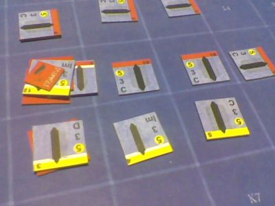 My ships are the red and I've pressed through Mike's line of yellows, damaging the one on the left with a solid raking pass and immobilizing the one next to it with a bone-crushing pass. Additional ships of mine moving at full speed are in the back, coming around behind to surround the end of his line.